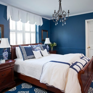 Example of a mid-sized classic guest dark wood floor bedroom design in Atlanta with blue walls and no fireplace