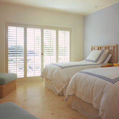 Island style guest bedroom photo in Other with gray walls