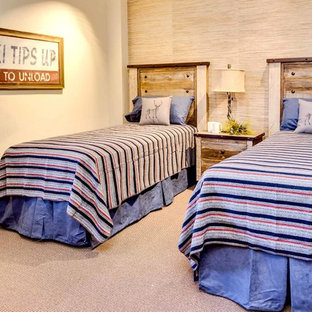 Example of a mountain style carpeted bedroom design in Denver with beige walls and no fireplace