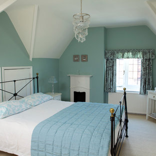 Inspiration for a timeless master carpeted bedroom remodel in Toronto with blue walls and a standard fireplace
