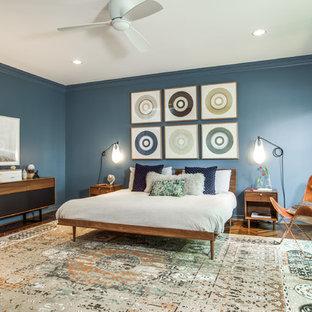 Bedroom - 1950s dark wood floor bedroom idea in Dallas with blue walls