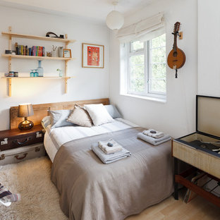 Bohemian bedroom in Manchester with white walls.