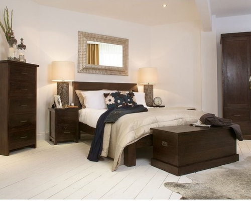 Photo Of A Medium Sized World Inspired Guest Bedroom In London With White  Walls And