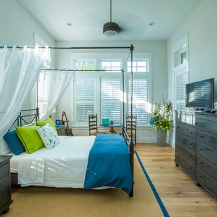 Bedroom - mid-sized coastal master light wood floor bedroom idea in Jacksonville with gray walls and no fireplace