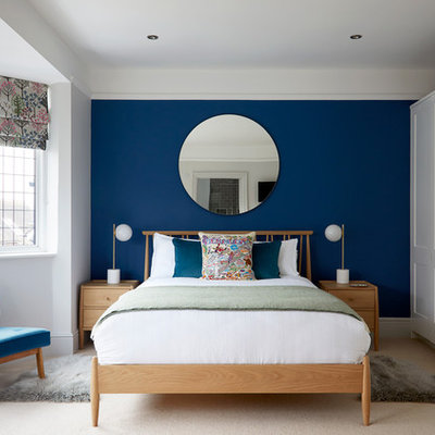 Inspiration for a transitional carpeted and beige floor bedroom remodel in Surrey with blue walls and no fireplace