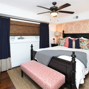 Island style dark wood floor bedroom photo in Orange County with white walls and no fireplace