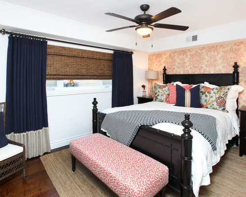 Island style dark wood floor bedroom photo in Orange County with white walls Coral And Navy Bedroom Ideas Photos  Houzz