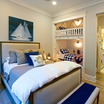 Bedroom - large coastal guest light wood floor and brown floor bedroom idea in Dallas with white walls and no fireplace