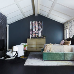 This is an example of a large transitional master bedroom in Los Angeles with black walls, black floor and wallpaper.