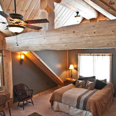 Rustic Bedroom by Summit Log & Timber Homes