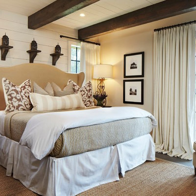 Mid-sized mountain style bedroom photo in Other with beige walls