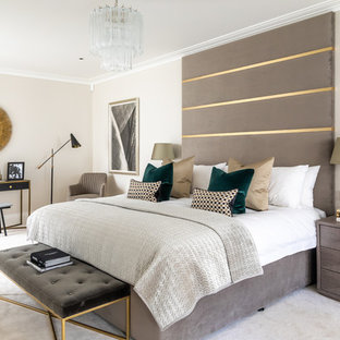 Design ideas for a contemporary master bedroom in London with beige walls, carpet and beige floors.