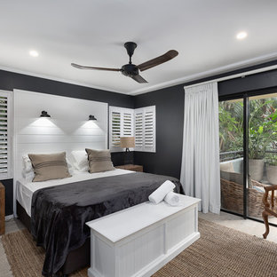Beach style bedroom in Sunshine Coast with blue walls and grey floor.