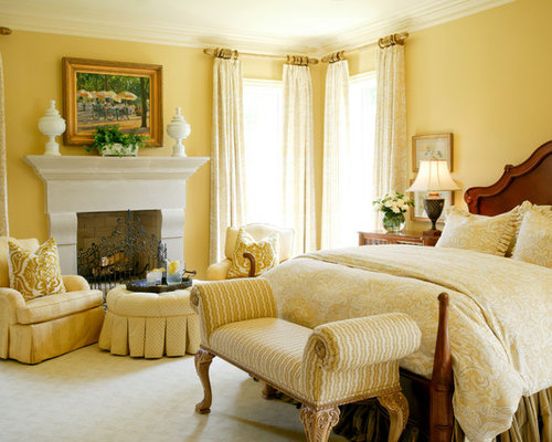 Traditional carpeted bedroom idea in Little Rock with yellow walls and a  standard fireplace. Yellow Bedroom   Houzz