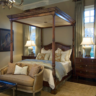 This is an example of a traditional bedroom in Nashville with beige walls, dark hardwood floors and no fireplace.
