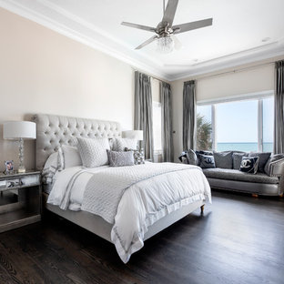 Photo of a large transitional master bedroom in Tampa with beige walls, dark hardwood floors and grey floor.
