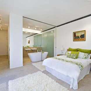 Trendy bedroom photo in Sydney with white walls