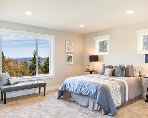 elegant master carpeted and beige floor bedroom photo in seattle with white walls - Lake House Design Ideas