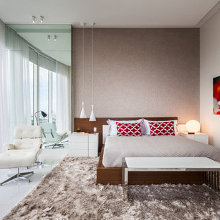Bedroom - large contemporary master porcelain tile bedroom idea in Miami with beige walls