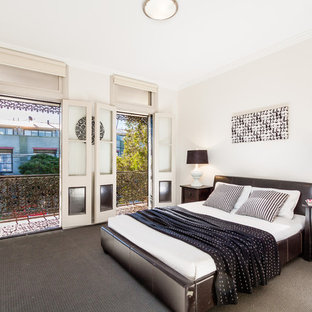 Inspiration for a mid-sized contemporary carpeted bedroom remodel in Sydney with white walls