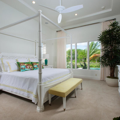 Beach style carpeted bedroom photo in Miami with white walls