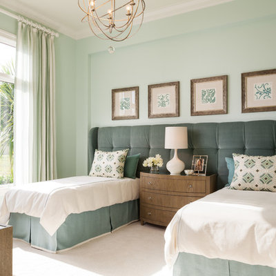 Example of a transitional guest carpeted and beige floor bedroom design in Miami with green walls