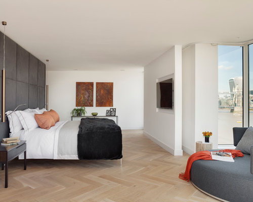 inspiration for a large modern light wood floor and beige floor bedroom remodel in london with - Flooring In Bedroom