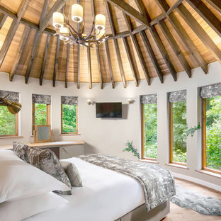 Inspiration for a medium sized rustic bedroom in Cambridgeshire with white walls, light hardwood flooring and beige floors.
