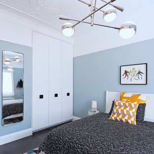 Inspiration for a contemporary bedroom in Sydney with blue walls, dark hardwood floors and brown floor.