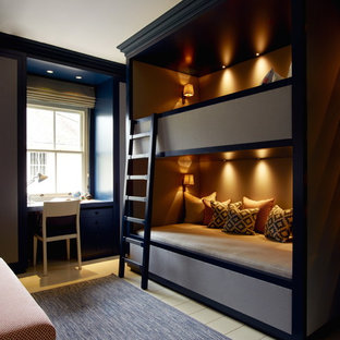 Photo of a medium sized modern guest bedroom in London with brown walls, painted wood flooring and beige floors.
