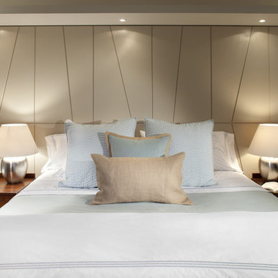 Inspiration for a contemporary bedroom remodel in Vancouver with beige walls