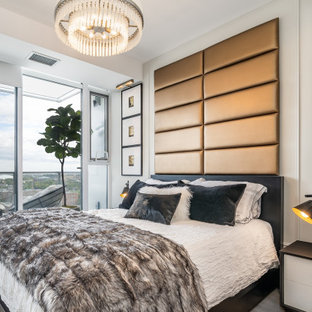 Design ideas for a small contemporary master bedroom in Vancouver with grey walls, light hardwood floors, grey floor and panelled walls.