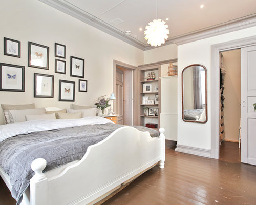 Example Of A Transitional Brown Floor Bedroom Design In Other With White Walls
