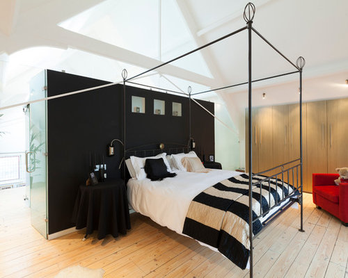 example of a trendy bedroom design in london with white walls