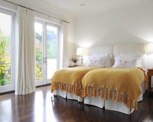 twin bedroom. Traditional guest dark wood floor bedroom idea in Los Angeles with white  walls Twin Bed Houzz