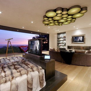 Example of a trendy master light wood floor bedroom design in Los Angeles with white walls