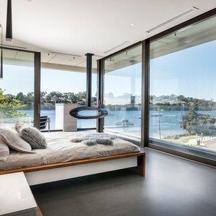 Photo of a large contemporary bedroom in Perth with black floor.