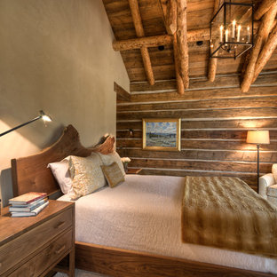 Inspiration for a large timeless master medium tone wood floor bedroom remodel in Other with beige walls and no fireplace