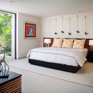 Design ideas for a large modern master bedroom in San Diego with white walls and ceramic floors.