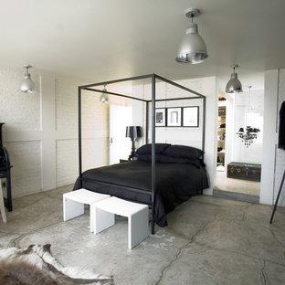 Diseño de dormitorio industrial con suelo de cemento y suelo gris