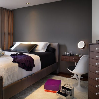Trendy bedroom photo in Singapore with black walls and no fireplace