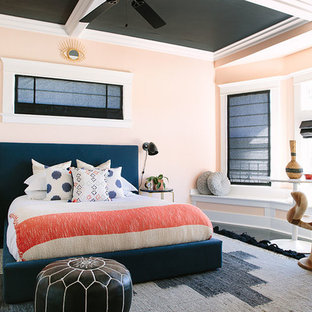 Design ideas for an eclectic bedroom in Los Angeles with pink walls.