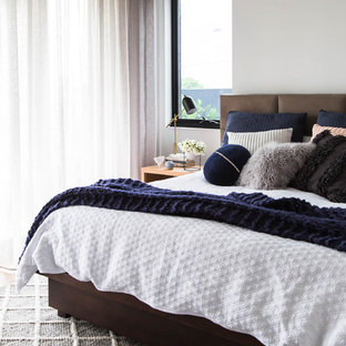 Design ideas for a contemporary master bedroom in Melbourne with white walls.