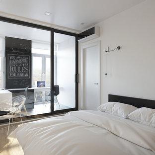 Imagen de dormitorio tipo loft, moderno, pequeño, con paredes blancas y suelo de madera pintada