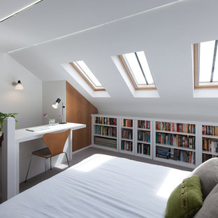 Design ideas for a contemporary mezzanine bedroom in London with white walls, carpet and grey floors.
