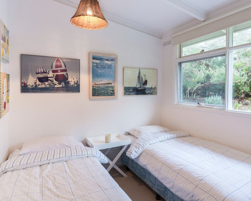 This Is An Example Of A Small Beach Style Bedroom In Melbourne With White  Walls And
