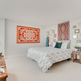 Example of an eclectic carpeted and beige floor bedroom design in DC Metro with gray walls