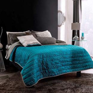 Modelo de dormitorio minimalista con suelo gris y paredes negras