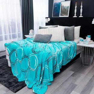 Ejemplo de dormitorio ecléctico con paredes negras y suelo gris