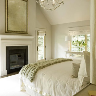 Transitional bedroom photo in Denver with beige walls and a standard fireplace